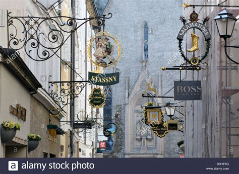 Medieval iron guild or craft signs hanging over shops in